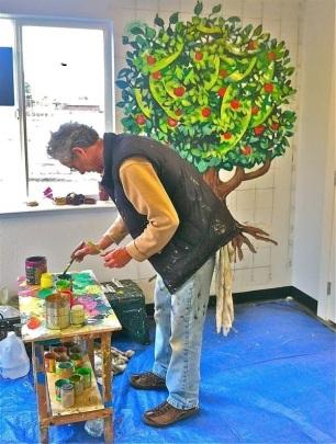 Seaside artist Billy Lutz at work.