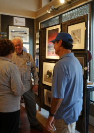 Neal Maine meeting and greeting art patrons.